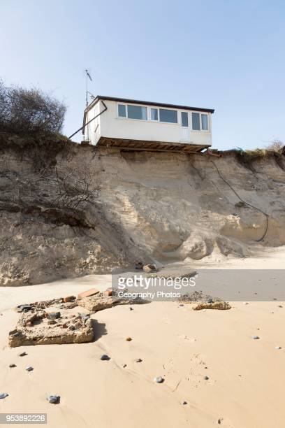 March 2018, Clifftop property collapsing due to coastal erosion after recent storm force winds, Hemsby, Norfolk, England, UK.