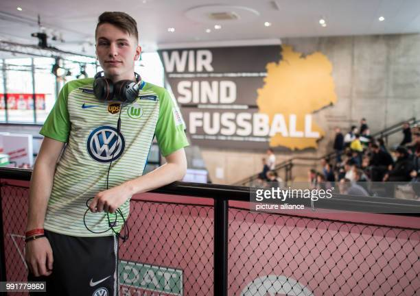 Final of the 2017/2018 virtual Bundesliga Player Timo Siep from VfL Wolfsburg standing in the football museum next to the sign 'wir sind Fussball'...