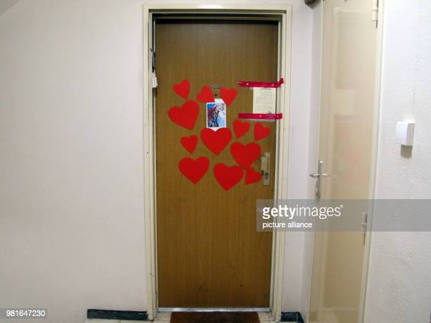 Hearts a photograph and a police seal glued to the door to the appartment of the 85yearold Holocaust survivor Mireille Knoll who was found dead on...