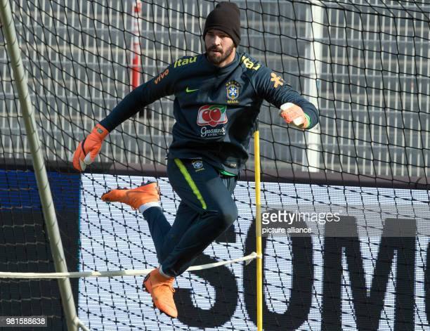 Brazil national squad training An der Alten Foersterei Stadium ahead of Germany vs Brazil friendly Brazil's goalkeeper Alisson jumps over a rope...