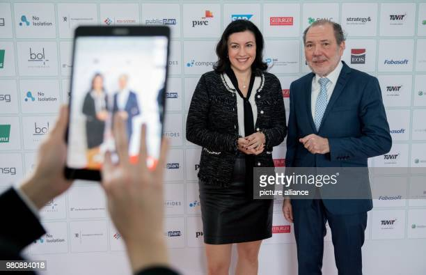 Dorothee Baer German state minister for digitalisation and Uwe Proll publisher and editorinchief of Behoerden Spiegel pose for a photograph at the...