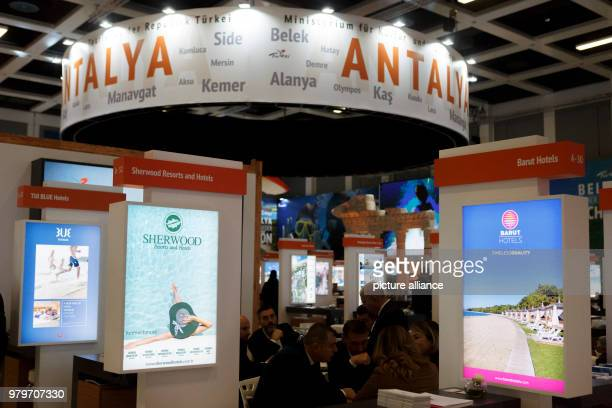 March 2018, Germany, Berlin: Exhibitors sit between the stands of the region Antalya in the Turkish hall of the International Tourism trade fair ....
