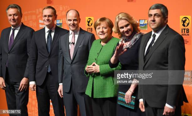 March 2018, Germany, Berlin: German Chancellor Angela Merkel of the Christian Democratic Union standing beside Michael Frenzel, President of the...