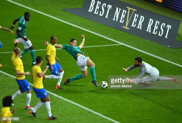 27 March 2018 Germany Berlin Olympia Stadium Soccer Friendly International matchGermany vs Brazil Germany's Mario Gomez attempts to score against...
