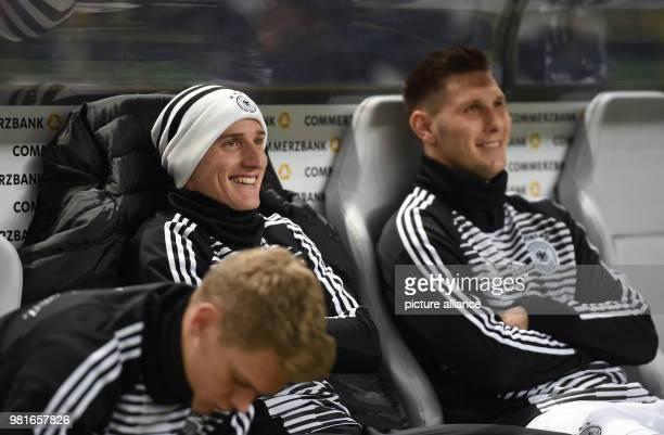 27 March 2018 Germany Berlin Olympia Stadium Soccer Friendly International matchGermany vs Brazil Germany's Sebastian Rudy and Niklas Suele sit on...