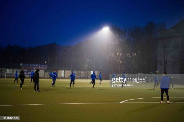 Players train at dusk In the year 1986/87 BlauWeiß 90 belonged to the best 18 teams in Germany Nowadays the soccer club plays in the BerlinLiga Photo...