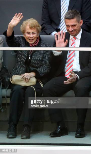 The mother of German Chancellor Angela Merkel Herlind Kasner the son of Merkel's husband Daniel Sauer sit in the gallery before the election of...