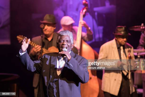The singer Jose Alejandro 'Capullo' Bolanos Herrera of 'The Bar at Buena Vista Grandfathers of Cuban Music' performs with his band on the stage of...
