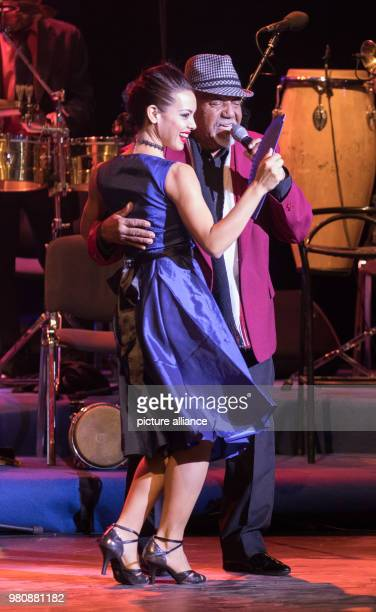 The singer Rene Perez Azcuy of 'The Bar at Buena Vista Grandfathers of Cuban Music' performs on the stage with a dancer at the Friedrichstadtpalast...