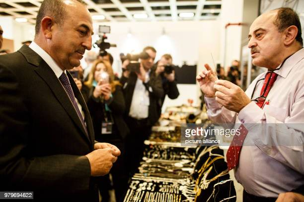 March 2018, Germany, Berlin: Turkish Minister of Foreign Affairs Mevlut Cavusoglu visits an exhibitor of the Turkey hall at the International Tourism...