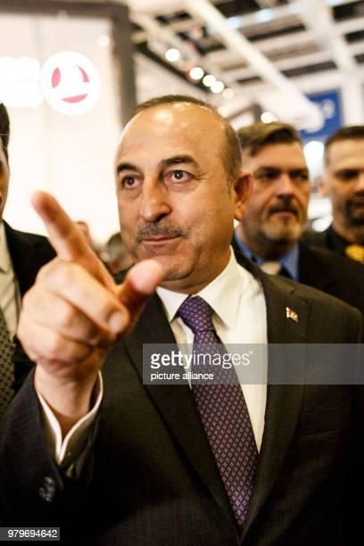 March 2018, Germany, Berlin: Turkish Minister of Foreign Affairs Mevlut Cavusoglu visits the International Tourism trade fair . Cavusoglu represents...