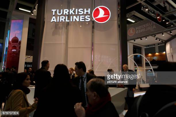 March 2018, Germany, Berlin: Visitors walk in front of the stand of the airline Turkish Airlines in the Turkish hall of the International Tourism...