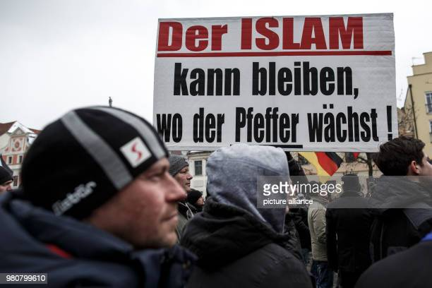 """March 2018, Germany, Cottbus: Participants in an anti-refugee demonstration by the group """"Zukunft Heimat"""". Photo: Carsten Koall/dpa"""