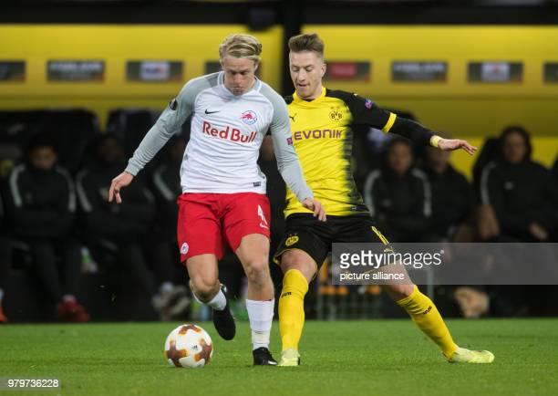 Europa League match between Borussia Dortmund and RB Salzburg Signal Iduna Park Dortmund's Marco Reus and Salzburg's Xaver Schlager vie for the ball...