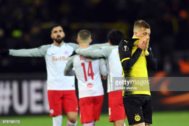 Europa League match between Borussia Dortmund and FC Salzburg Signal Iduna Park Dortmund's Marco Reus looks disappointed while his opponents...