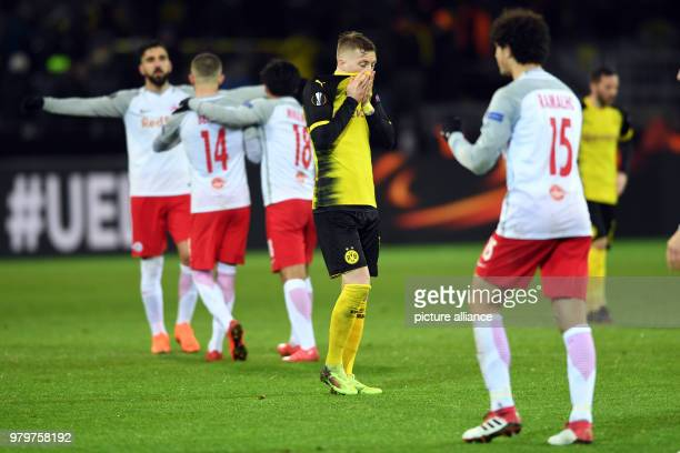 Europa League match between Borussia Dortmund and RB Salzburg Signal Iduna Park Dortmund's Marco Reus touches his face while Salzburg's players...
