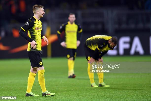 Europa League match between Borussia Dortmund and RB Salzburg Signal Iduna Park Dortmund's Marco Reus Gonzalo Castro and Omer Toprak stand on the...