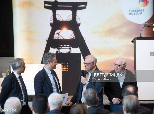 Olaf Thon LR museum director ManuelNeukirchner Bernhard Dietz and Willi 'Ente' Lippens participate in a panel discussion during the opening of the...