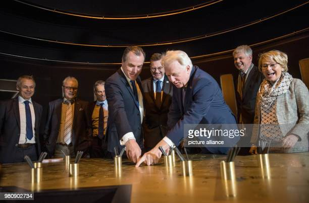 The chairman of Schalke's supervisory board Clemens Toennies German FootballAssociation President Reinhard Grindel and Ullrich Sierau Dortmund's...