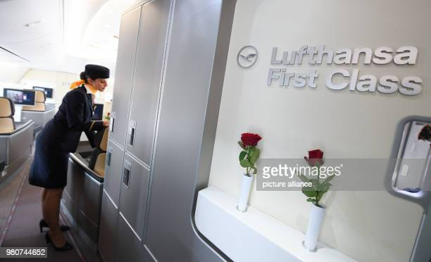 Flight attendant Natalie Reis prepares the first class section for boarding onboard a Boeing 747800 aircraft of German carrier Lufthansa Photo Arne...