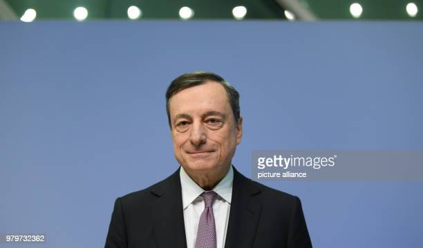 Mario Draghi President of the European Central Bank taking a seat during the begin of the press conference at the ECB headquarters Europe's highest...