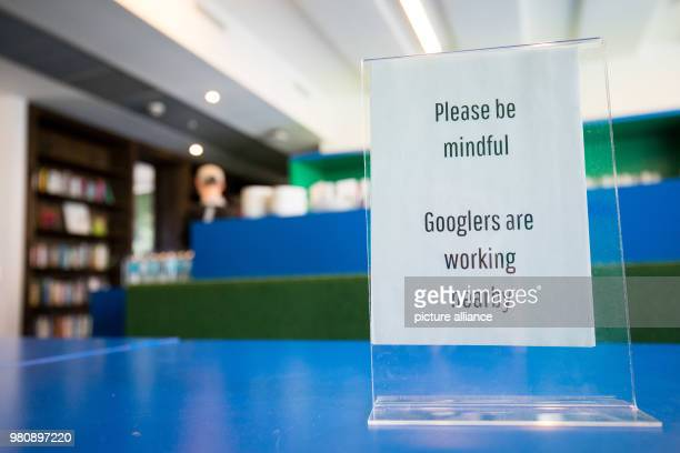 A sign reading ' Please be mindful Googlers are working nearby' in a socalled microkitchen at Google's headquarters in Hamburg Google released...