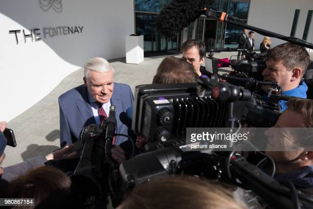 March 2018, Germany, Hamburg: Logistics billionaire and Hamburger SV investor Klaus Michael Kuehne engages with journalists outside 'The Fontenay'....