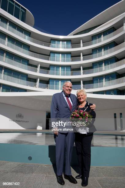 March 2018, Germany, Hamburg: Logistics billionaire and Hamburger SV investor Klaus Michael Kuehne and his wife Christine stand outside 'The...