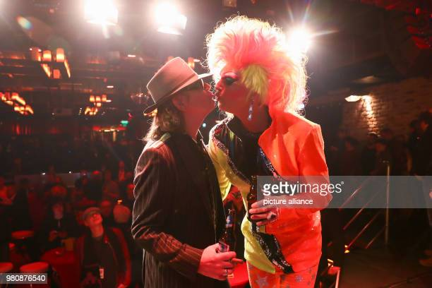 Rockstar Udo Lindenberg and Drag Queen Olivia Jones stand on stage during the opening of the 'Panik City The UdoLindenbergExperience' The musician...