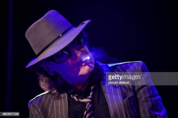Rockstar Udo Lindenberg performs on stage with a vaporizer during the opening of the 'Panik City The UdoLindenbergExperience' The musician opened an...
