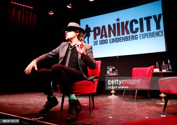 Rockstar Udo Lindenberg sits on stage during the opening of the 'Panik City The UdoLindenbergExperience' The musician opened an adventure world with...