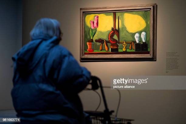 An elderly woman with rollator looks at the paintings 'Stillleben mit Hyazinthe' by Karl SchmidtRottluff at the Bucerius Arts Forum in Hamburg The...