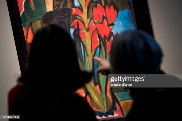 Two elderly women stand in front of the painting 'Stillleben mit roten Blueten' by Karl SchmidtRottluff at the Bucerius Arts Forum in Hamburg The...