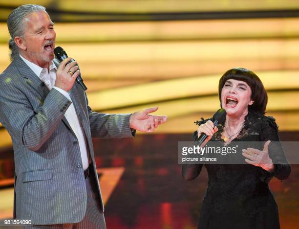 Actor Patrick Duffy and Mireille Mathieu perform together at the ZDFGala 'Welcome to Carmen Nebel' in the Freedom Hall Hof The show will be presented...