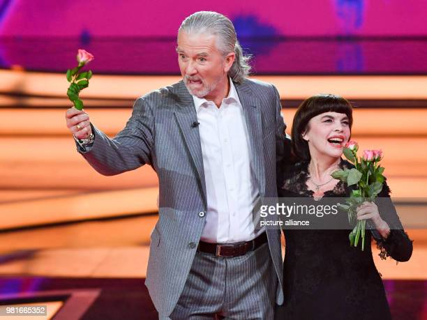 March 2018, Germany, Hof: Mireille Mathieu and Patrick Duffy singing together at the gala 'Willkommen bei Carmen Nebel' on the ZDF channel. Photo:...