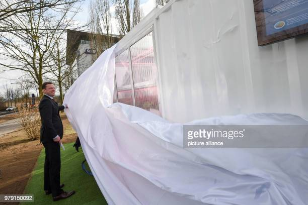 Burkhard Lohr CEO of the Kassel fertilizer and salt producer KS AG uncovers the Aquaponics research container at the company's headquarter Aquaponics...