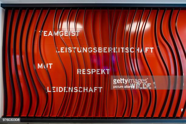 A wall in the foyer of a building reads 'Teamgeist' 'Leistungsbereitschaft' 'Mut' 'Respekt' 'Leidenschaft' and 'Wille' on the grounds of the FC...