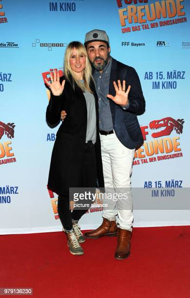 Actor Adnan Maral and his wife Frau Franziska arriving at the premiere of 'Fünf Freunde und das Tal der Dinosaurier' The film arrives in cinemas on...