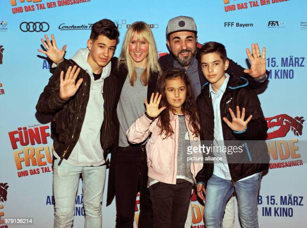 Actor Adnan Maral his wife Frau Franziska and their children Acan Can and Imel arriving at the preimere of 'Fünf Freunde und das Tal der Dinosaurier'...