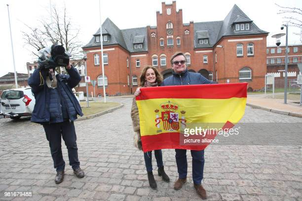 Christian Harhoff and his wife Ana Lopez Yelamos holding a Spanish flag and speaking with journalists in front of the correctional facility in...