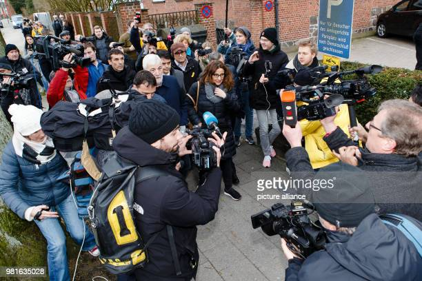 Reporters surround party members of the 'Partit Democratra Europeu Catalá' Josep Ruis Marc Castells Mercè Conesa and Qim Torra while standing in...
