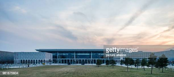 The sun setting behind the terminal building of the 'Willy Brandt' Capital Airport Berlin Brandenburg Photo Christophe Gateau/dpa