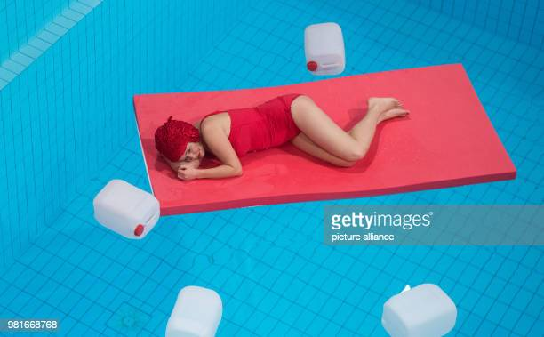 Kathrin Hildebrand in the role of Frau A performs at the indoor pool of Heslach in the play 'Retrotopia' of the theatre group Lokstoff Photo Marijan...