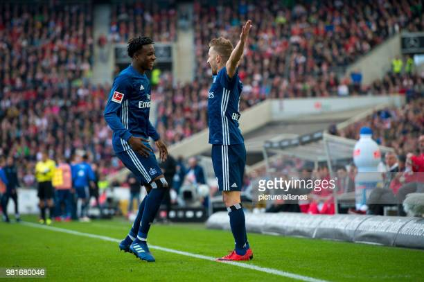 soccer 1st Bundesliga VfB Stuttgart vs Hamburger SV in the Mercedes Benz Arena Hamburg's Gideon Jung and Lewis Holtby celebrating Holtby's scoring of...