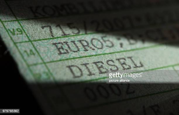 The words 'Diesel' and 'Euro5' are printed on a registration certificate of a car of the model Volkswagen T5 Photo Marijan Murat/dpa