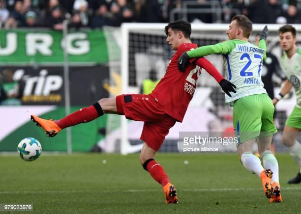 Soccer Bundesliga VfL Wolfsburg vs Bayer Leverkusen at the Volkswagen Arena Wolfsburg's Maximilian Arnold pulls back Leverkusen's Kai Havertz on the...