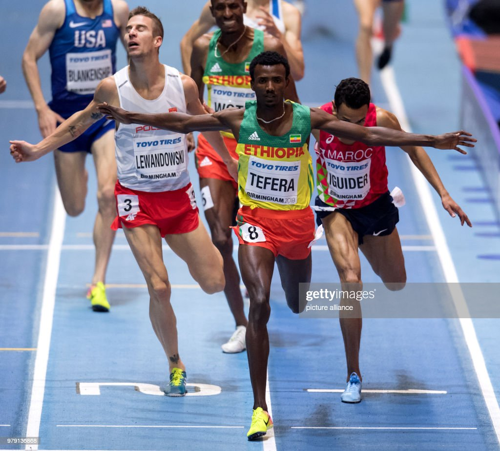 World Indoor Championships. Poland's Marcin Lewandowski (L-R), Ethiopia's Samuel Tefera and Morocco's Abdelaati Iguider running over the finish line of the 1500 metre race. Tefera won gold, Lewandowski silver and Iguider bronze. Photo: Sven Hoppe/dpa