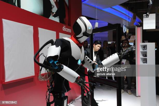 A robot from the Japanese Telekom company Docomo prepares to paint a picture at the Mobile World Congress 2018 by copying the movements of a human...