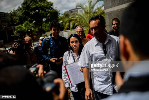 The delegate Delsa Solorzano hands over a document to UN representatives in the course of a protest in front of the UN headquarters in Caracas The...