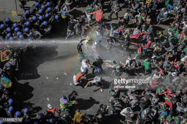 Algerian riot police clashes with demonstrators taking part in a mass protest against Algerian President Abdelaziz Bouteflika after his decision to...